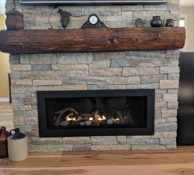 gas-fireplace-with-wooden-beam-on-top-of-mantle